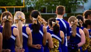 photo of cheerleaders in blue and white uniform